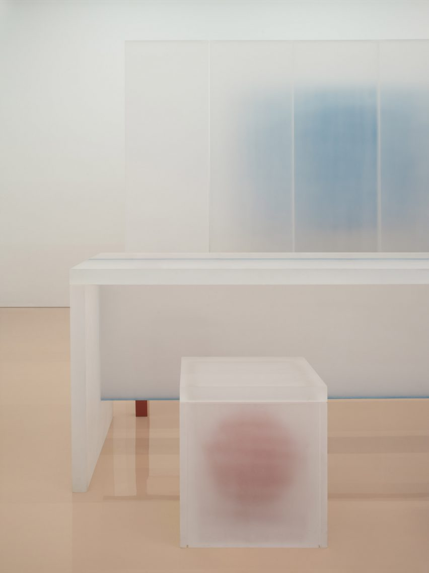 Steel-frame furniture wrapped in resin in Say Architects store interior