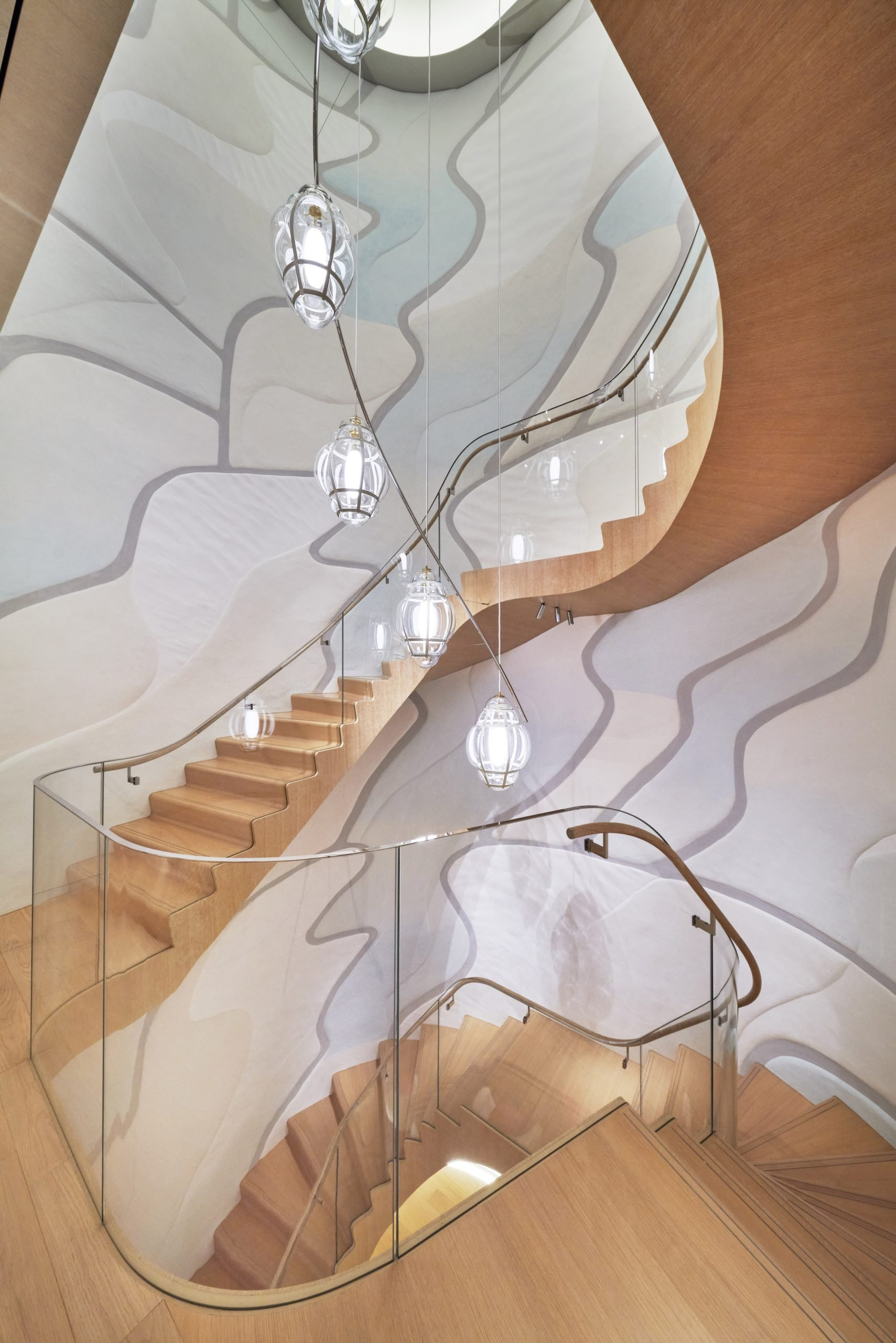Sculptural glass and oak staircase