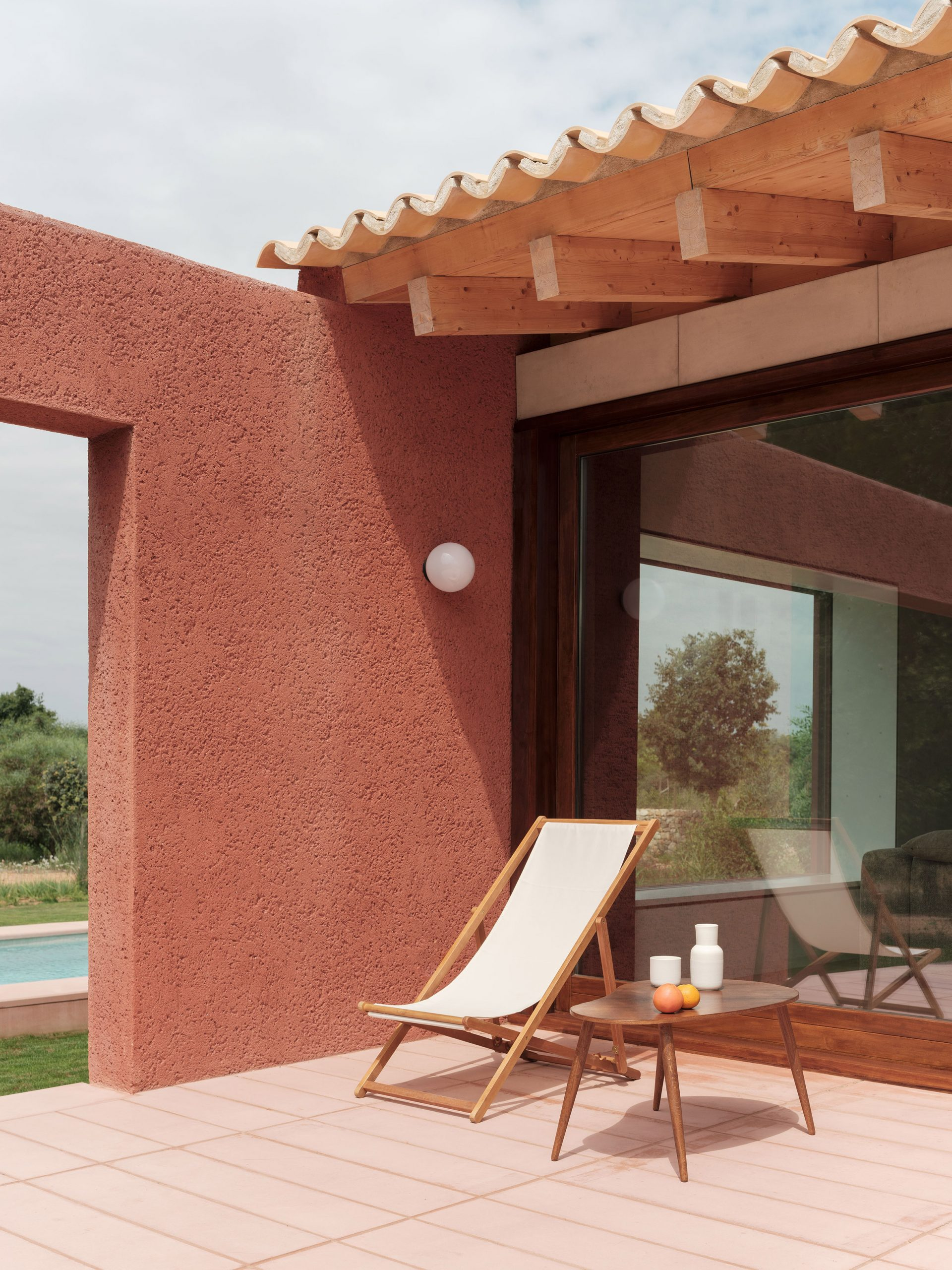 A tiled terrace outside a holiday home in Mallorca