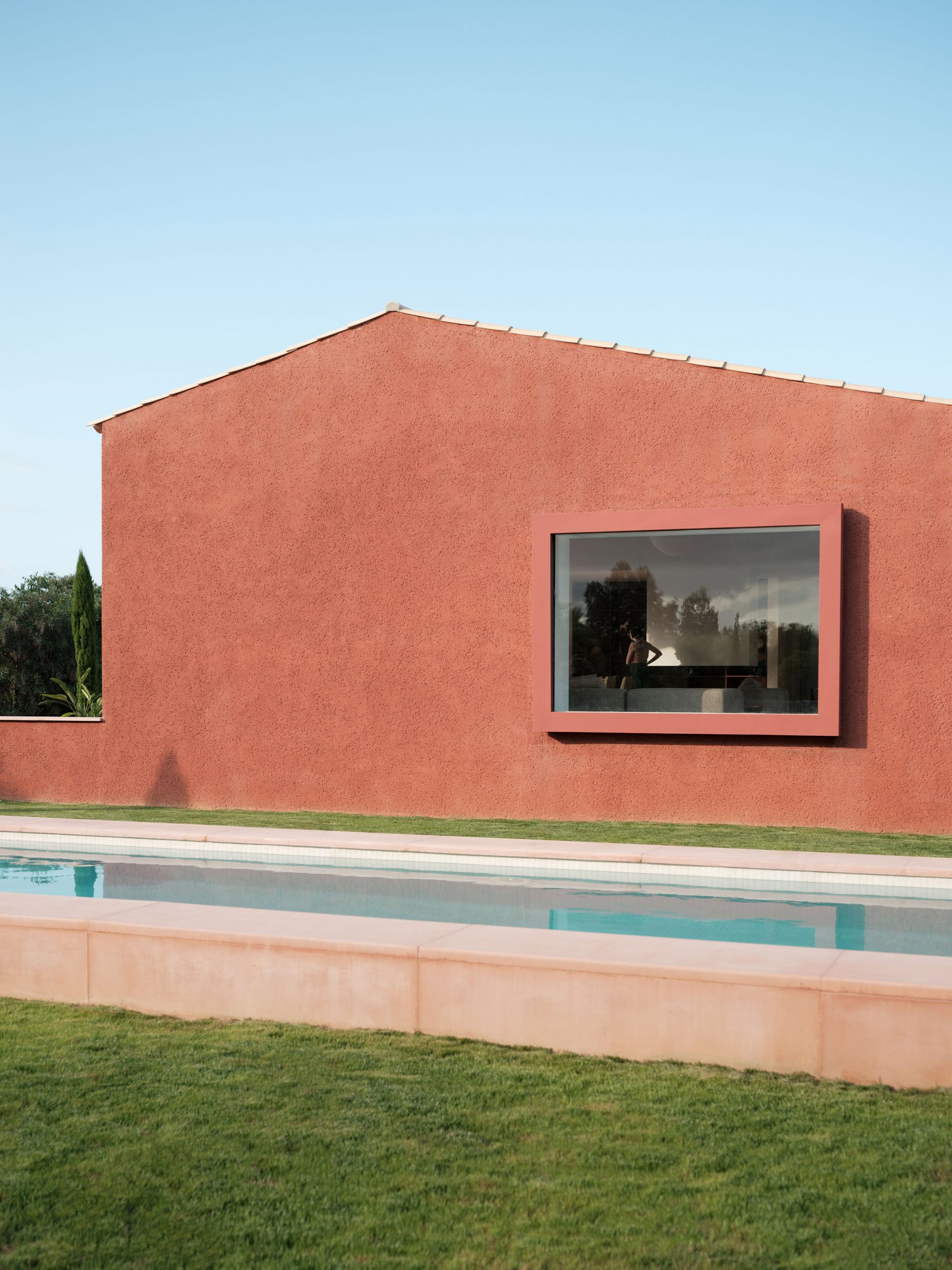 The red-coloured facade of a holiday home in Mallorca
