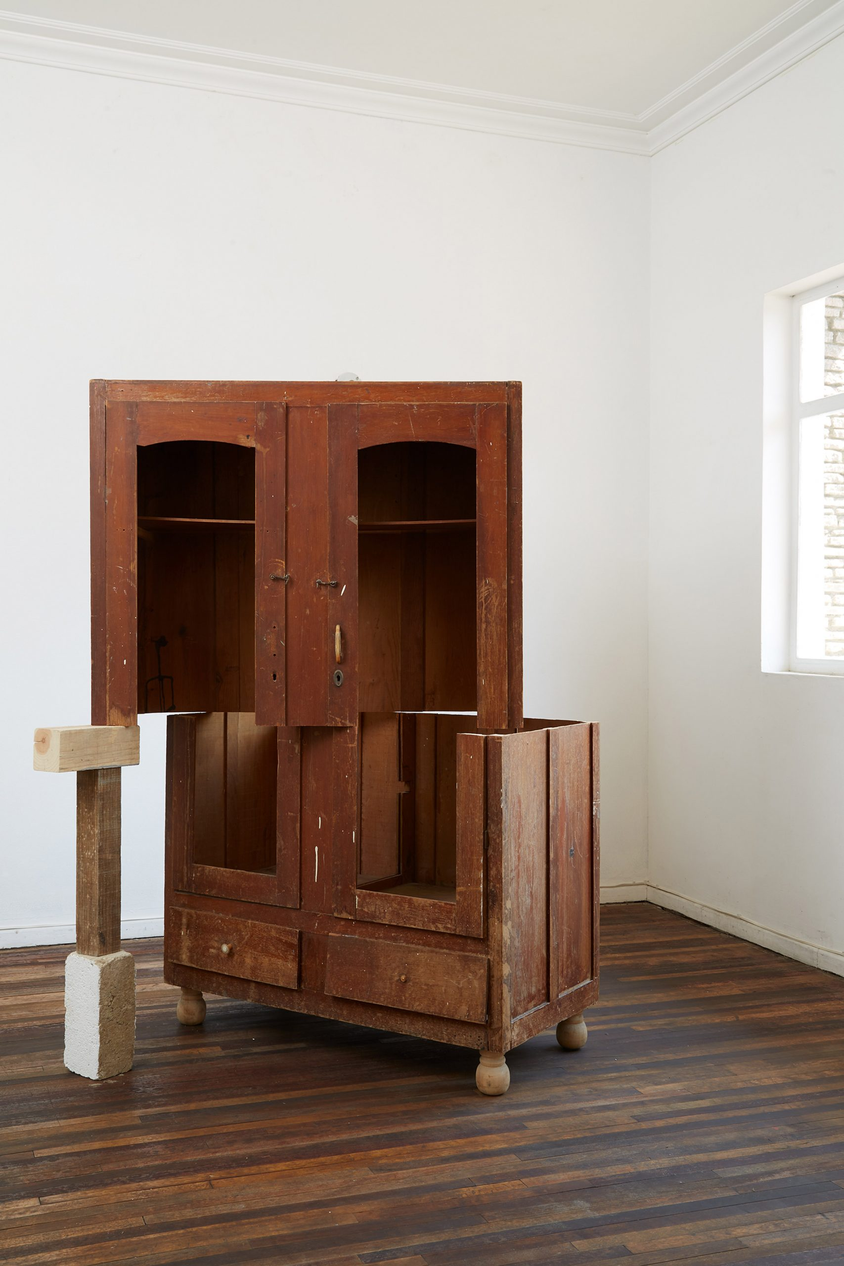 A fractured wooden cupboard