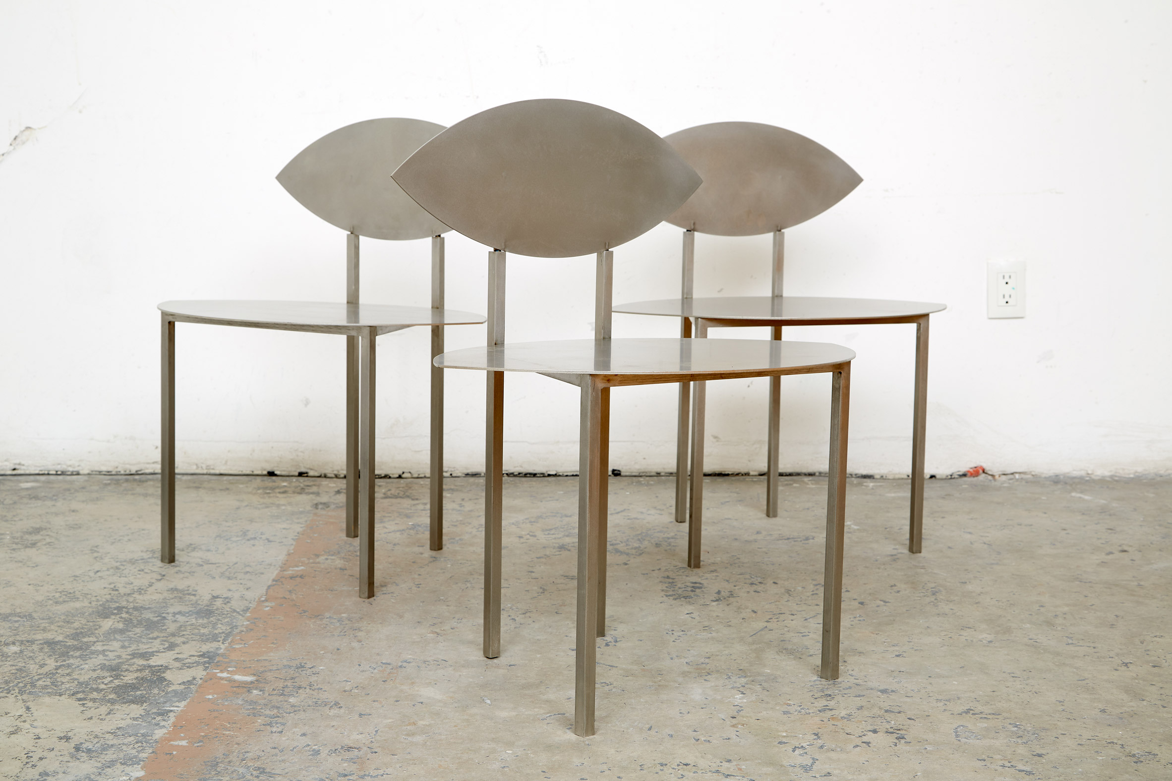 Stainless steel chairs by Georgian design duo Rooms