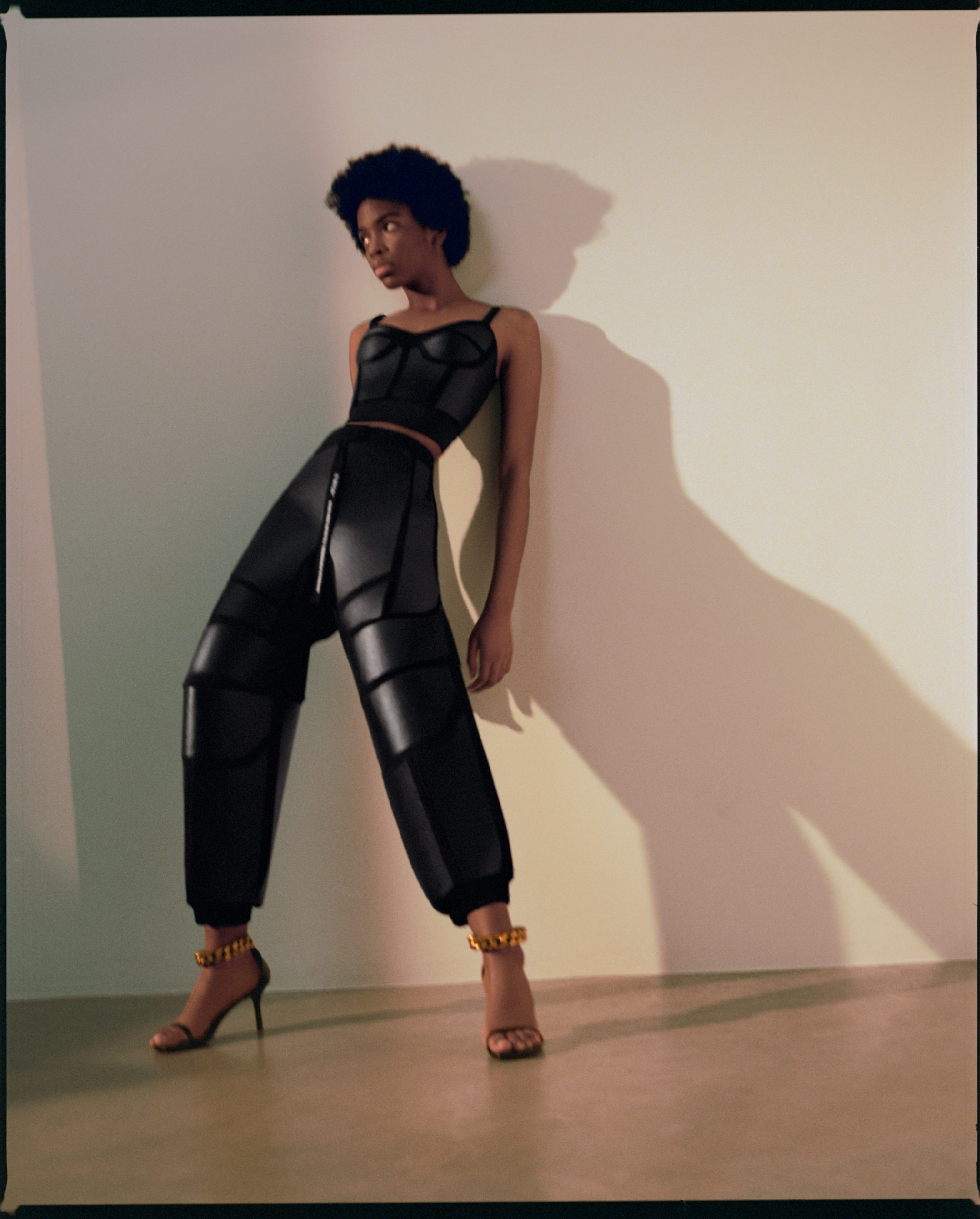 Full-body shot of model wearing mycelium leather clothing by Stella McCartney