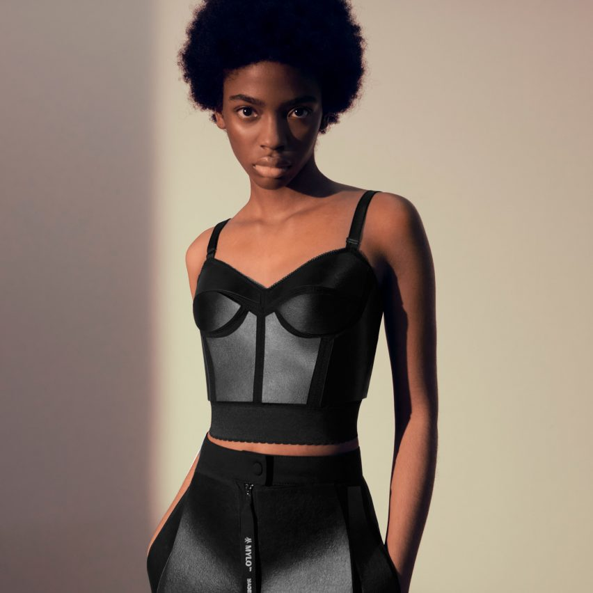Model wearing black two-piece created by Stella McCartney from Mylo mycelium leather