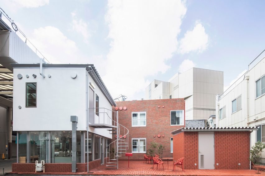 Brick-clad houses and brick courtyard