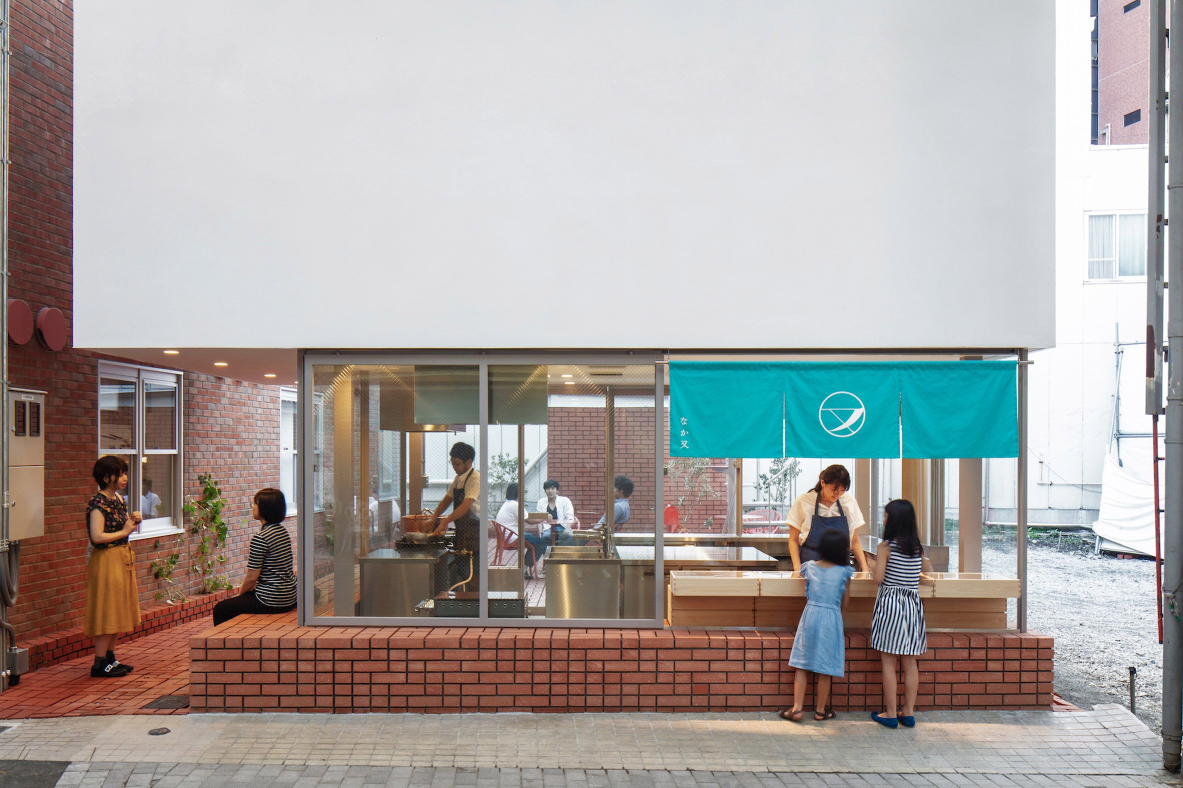 Customers outside brick-clad sweet store