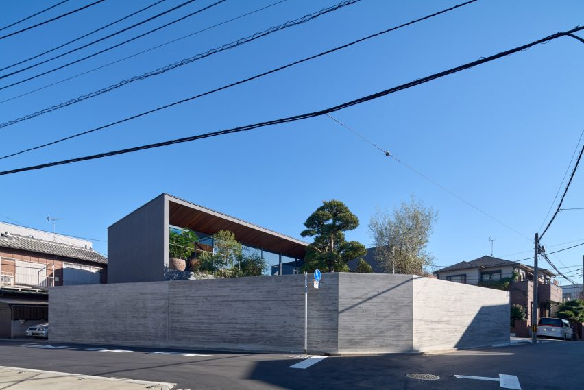 A concrete wall surrounds the home