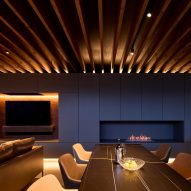 A fireplace is recessed into the wall