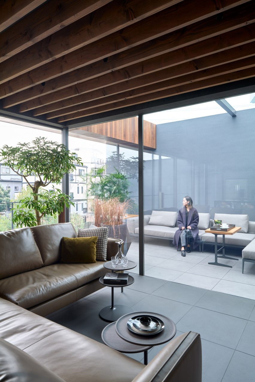 Tiled flooring runs through the interior and exterior by Apollo Architects & Associates