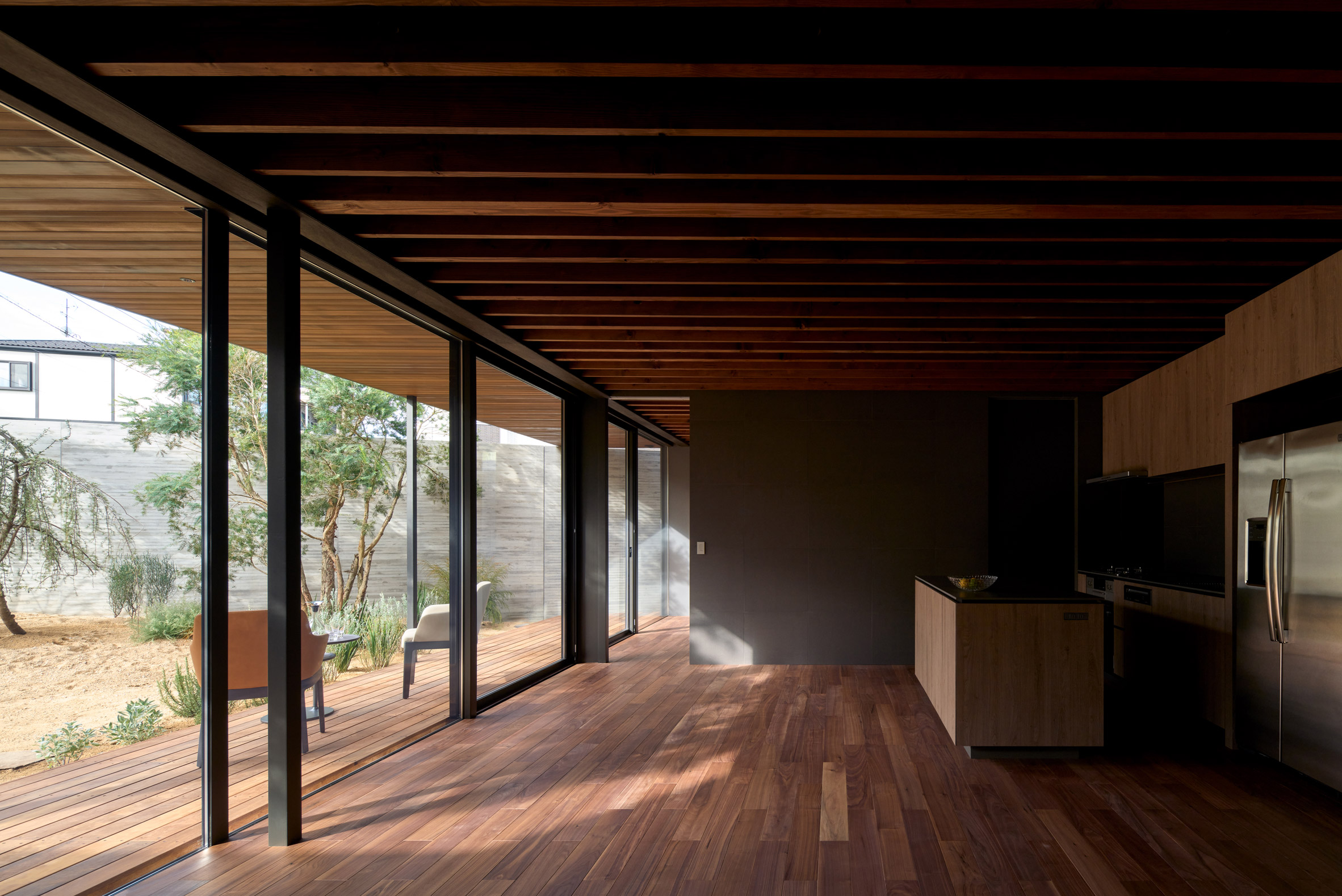 Exposed beams line the ceiling by Apollo Architects & Associates