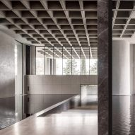 The concrete and marble entrance of an office