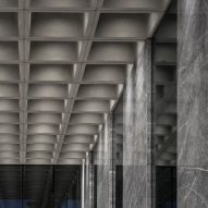 An office entrance with a waffle slab ceiling