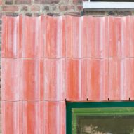 Pink concrete cladding on a house extension