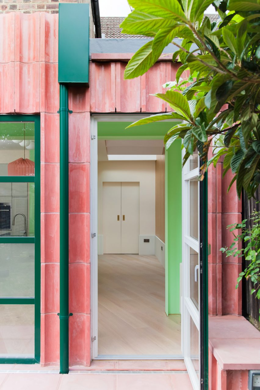 An entrance to a pink-coloured concrete house extension