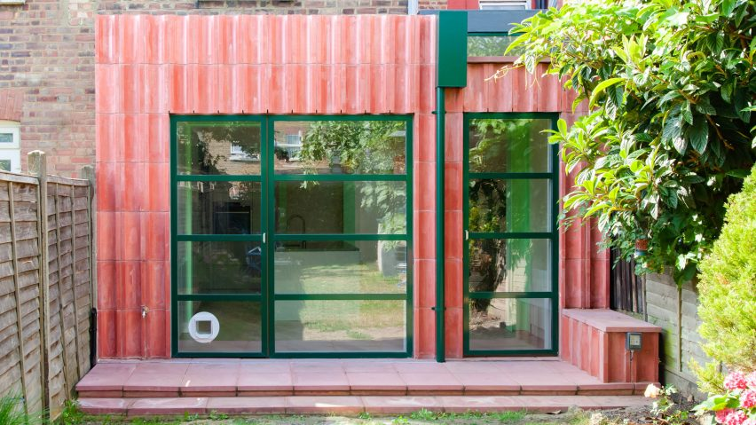 A kitchen extension clad in pink concrete