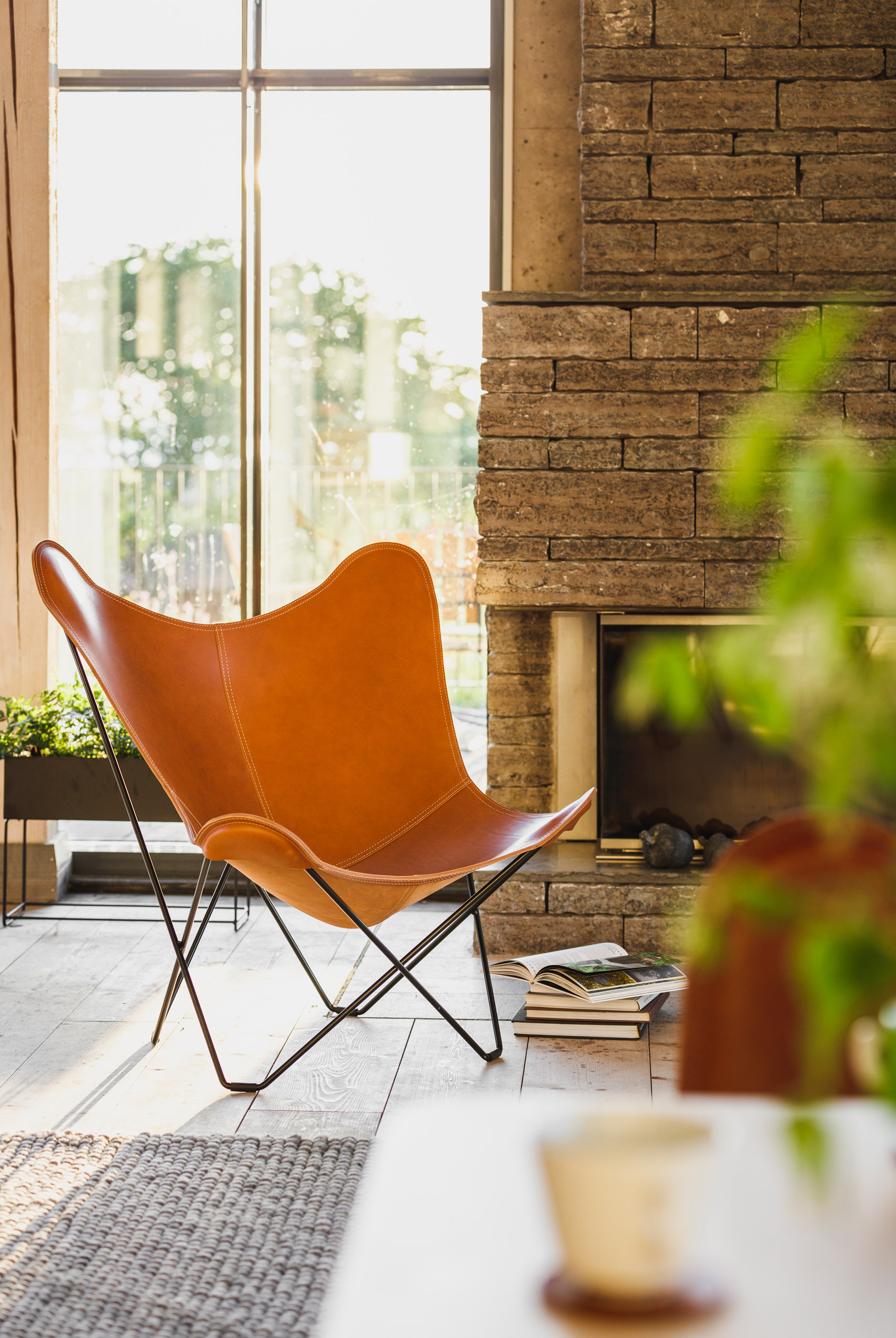 A butterfly chair made with brown leather