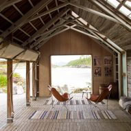 A barn with a pair of leather lounge chairs