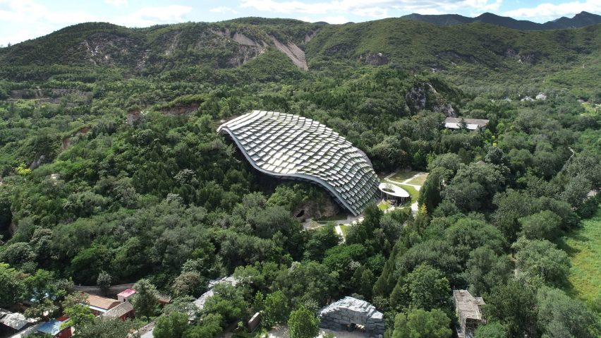 An undulating shelter made from overlapping panels