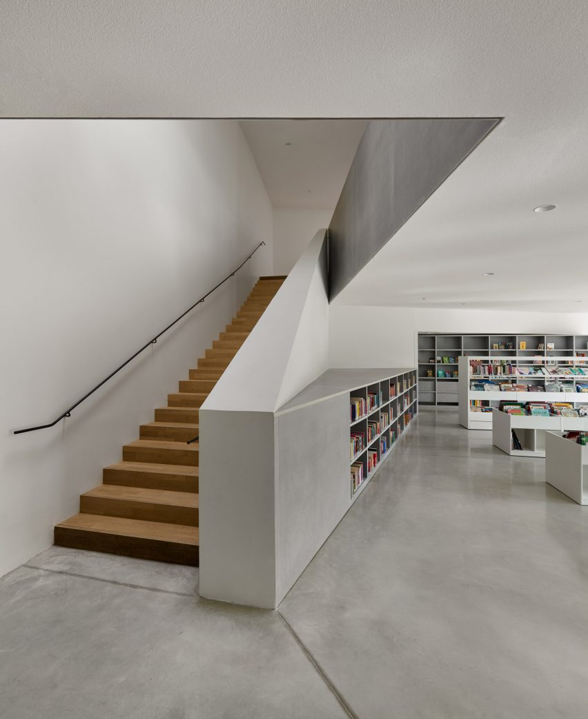 Concrete is paired with wooden stairs by Dominique Coulon & Associés