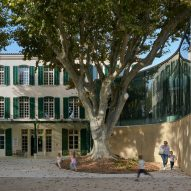 Dominique Coulon & Associés adds curved glass extension to library in a renovated French manor
