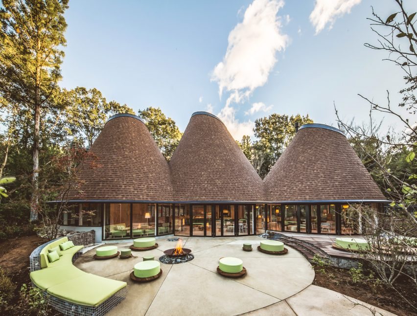 Clubhouse in three timber cones