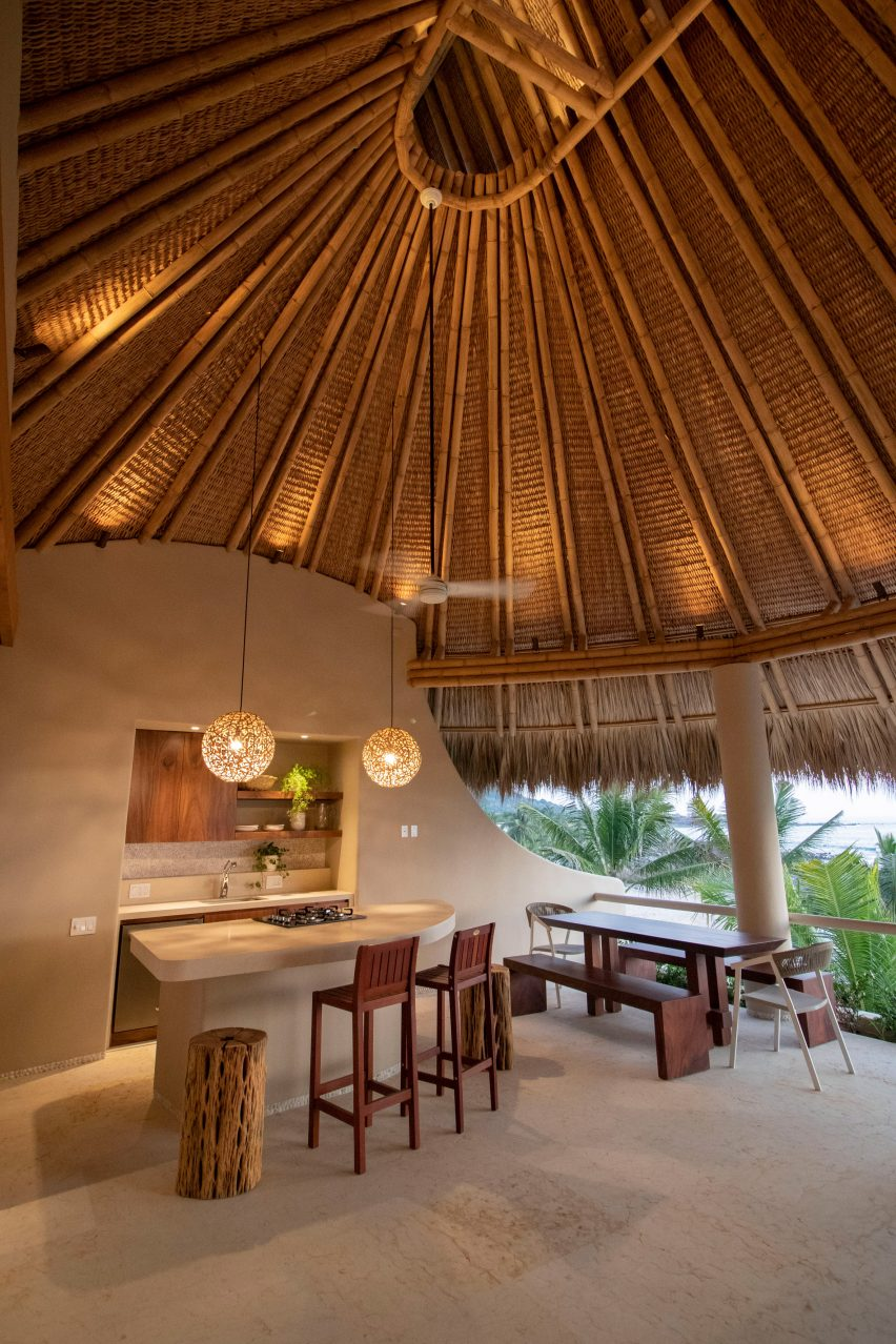 An interior view from under the thatched roof