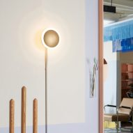 A light fixture against a pastel wall