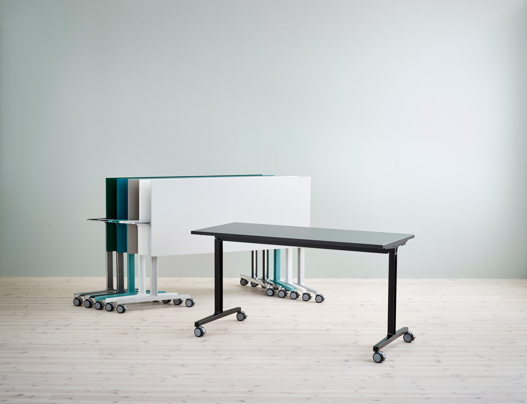 Folded and stacked tables by Flokk