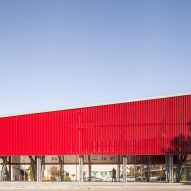 An angular red pavilion