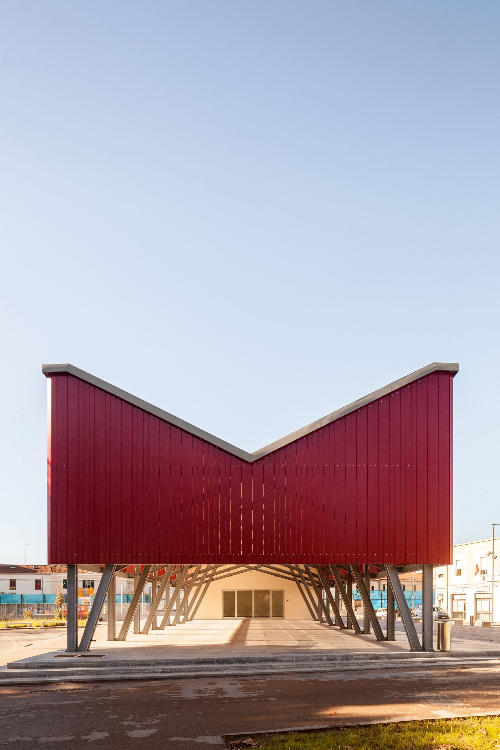 A covered events space with red cladding