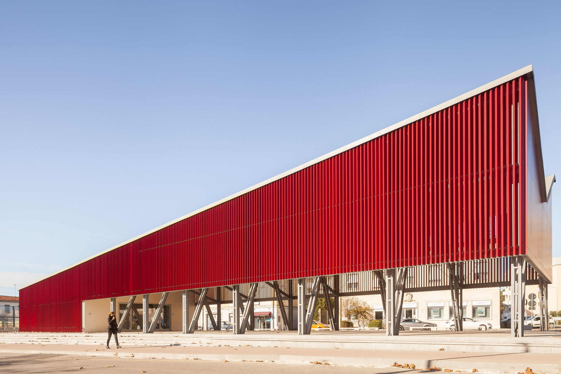 A pavilion clad in red aluminium slats