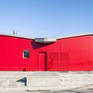 The red facade of a public pavilion