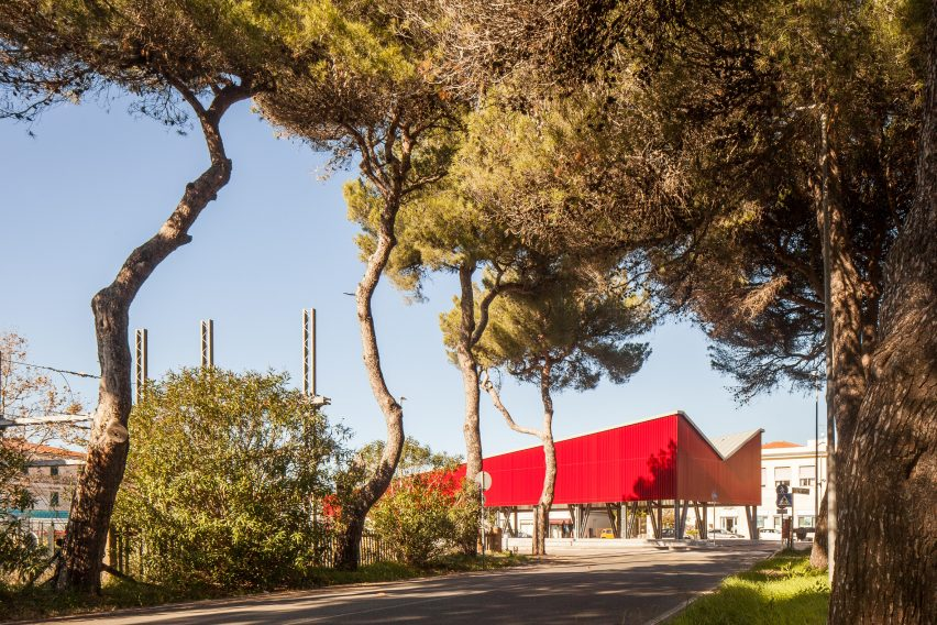A Italian square with a red pavilion