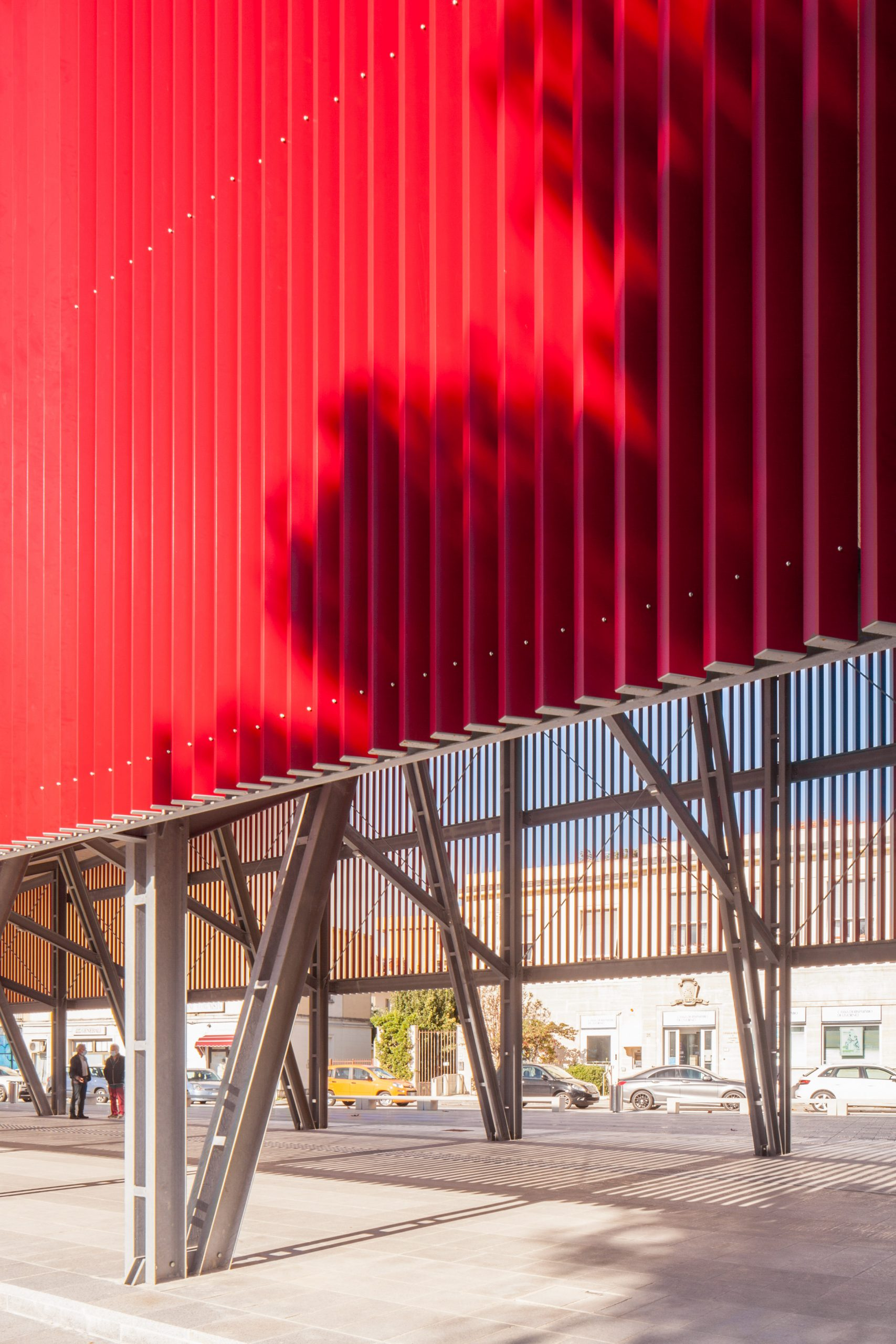 A canopy made with from red slats of aluminium