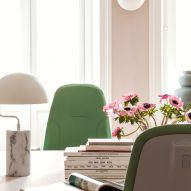 Green office chair by decorative desk