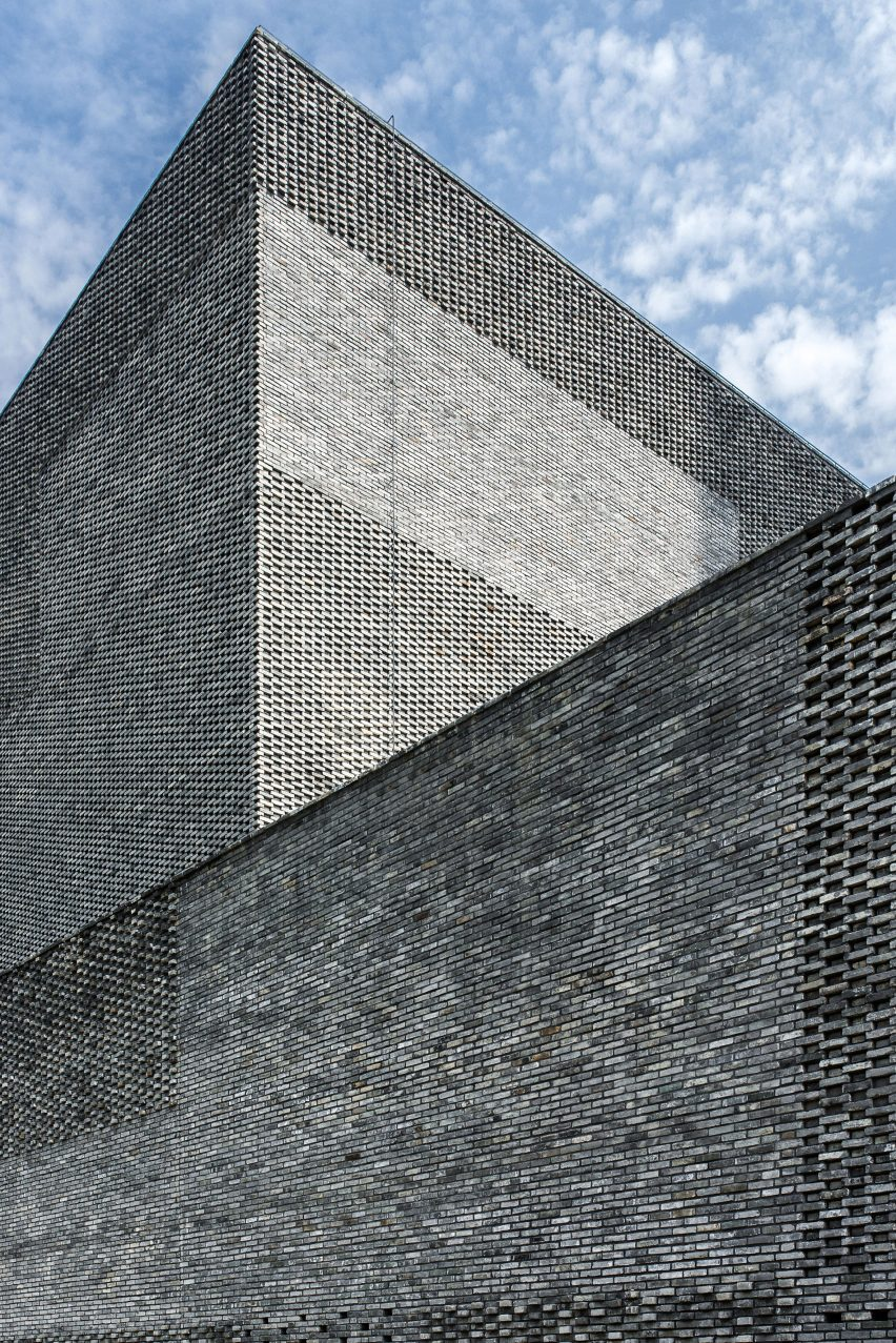 A tactile facade made from recycled grey bricks