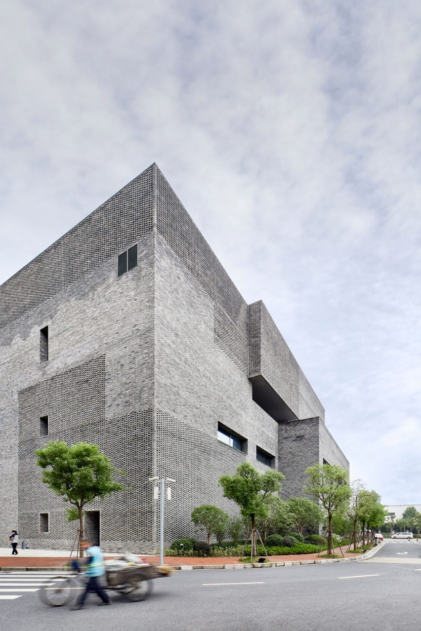 A grey brick research facility at Schindler City campus by Neri&Hu