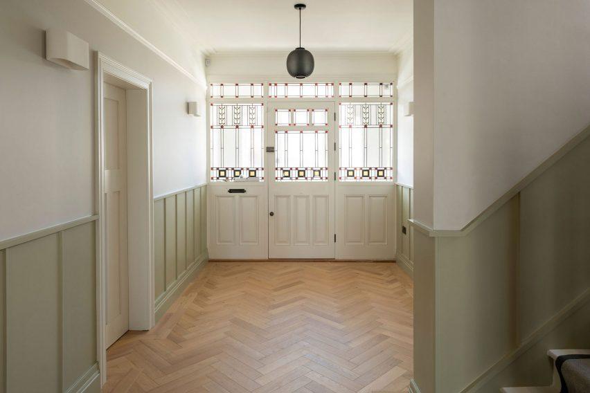 The entrance hall has herringbone floors