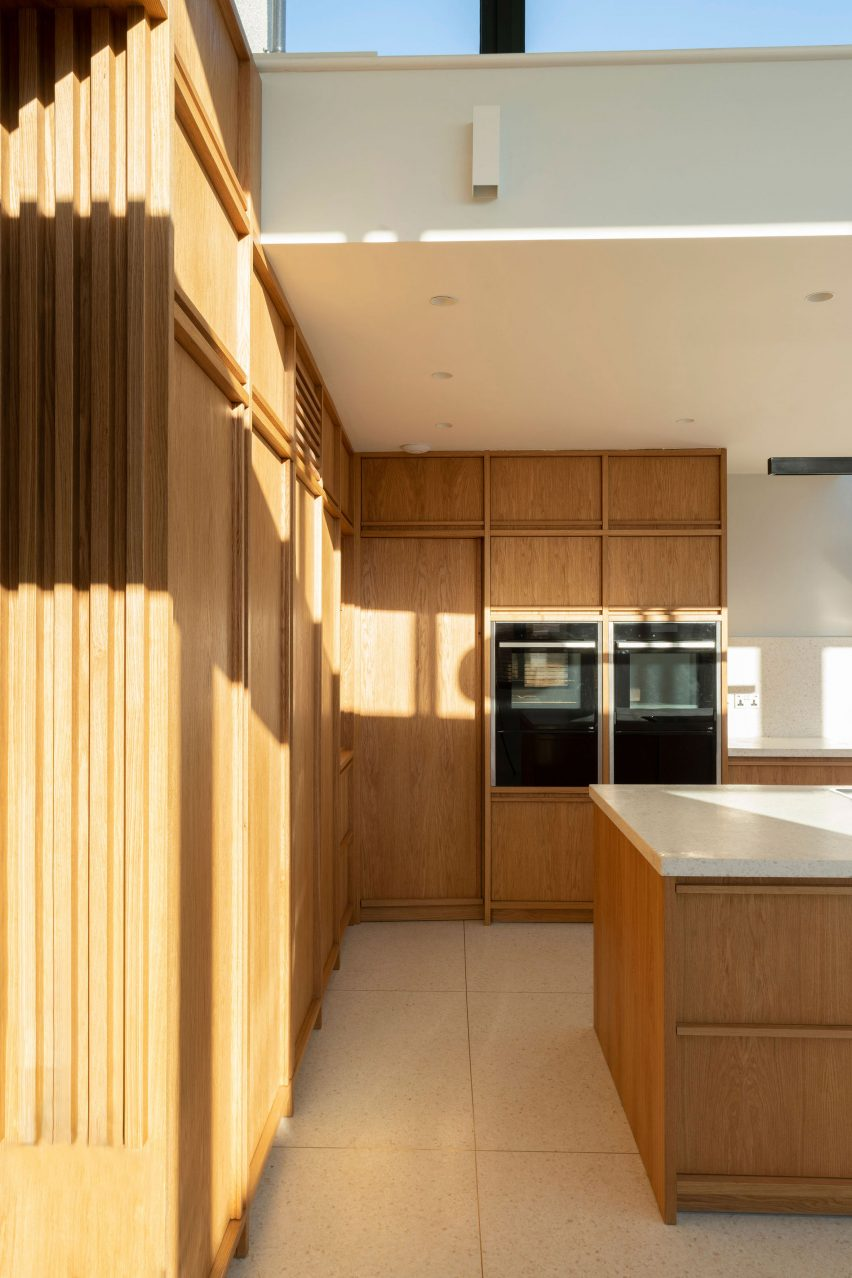 It has wooden cabinetry by Scullion Architects