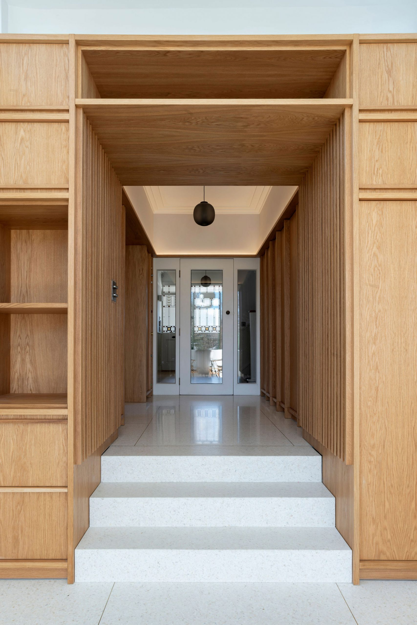 Lobby area employs a wood and terrazzo scheme
