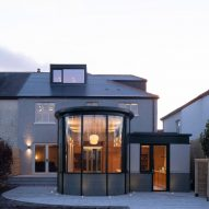 Scullion Architects adds curved-glass extension to 1930s home in Dublin