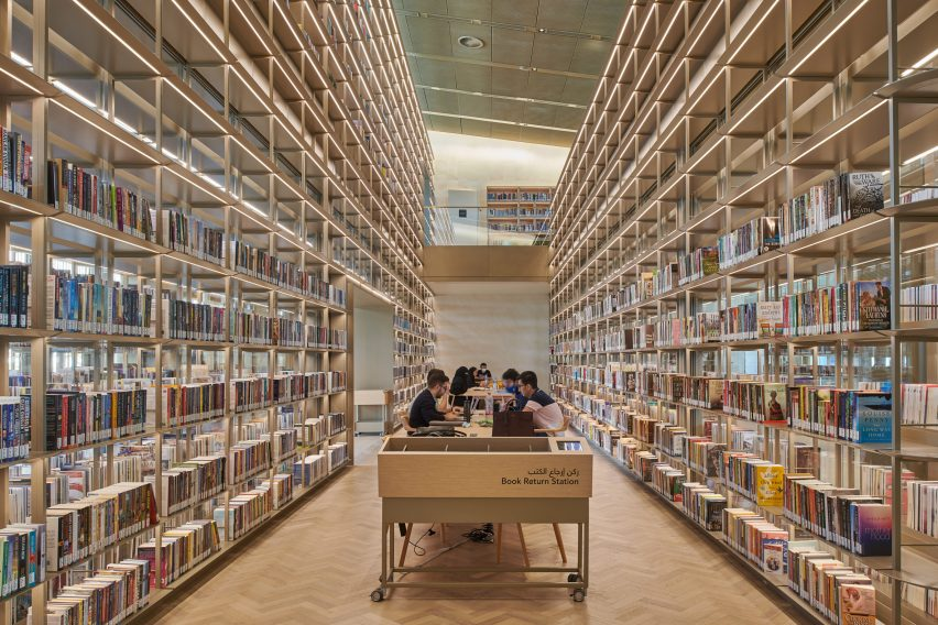 A book-filled reading space in a library by Foster + Partners