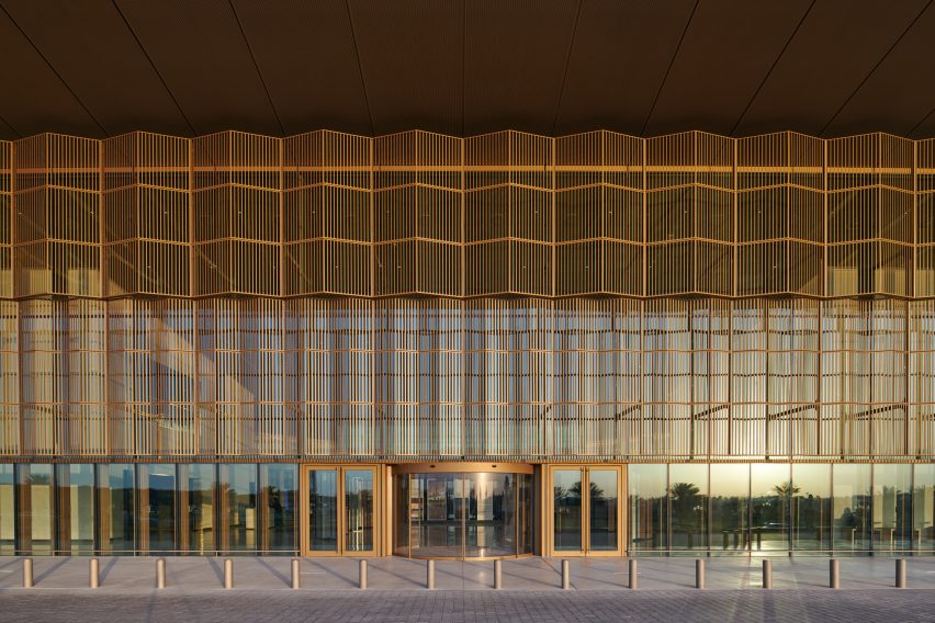 A glazed facade lined with aluminium screens for solar shading