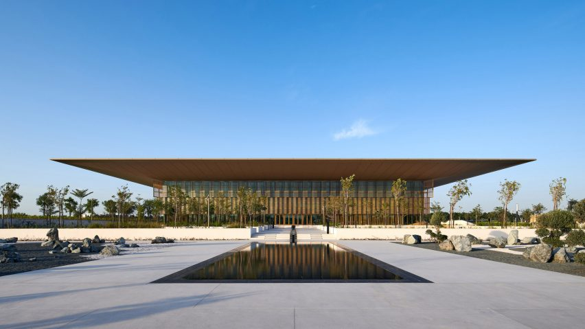 A library with a large overhanging roof in Sharjah