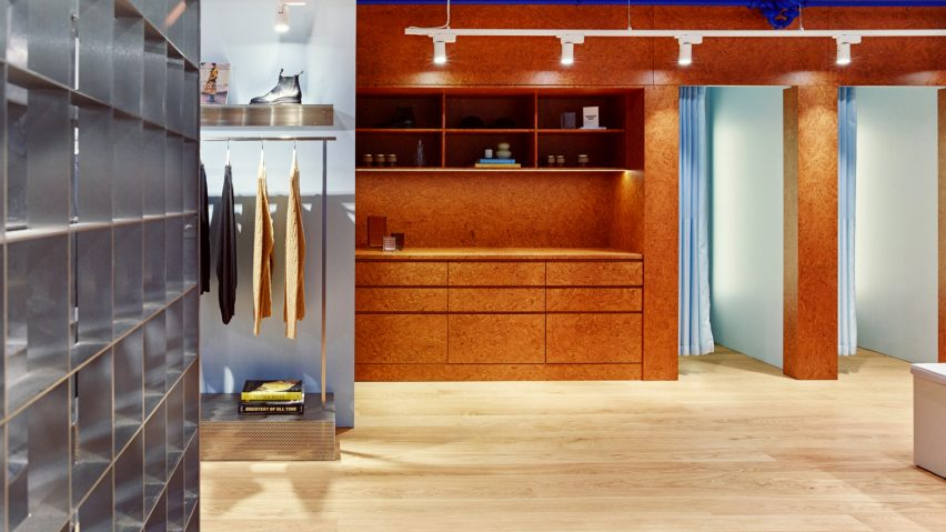Burl wood joinery in an Oslo store interior designed by Snøhetta