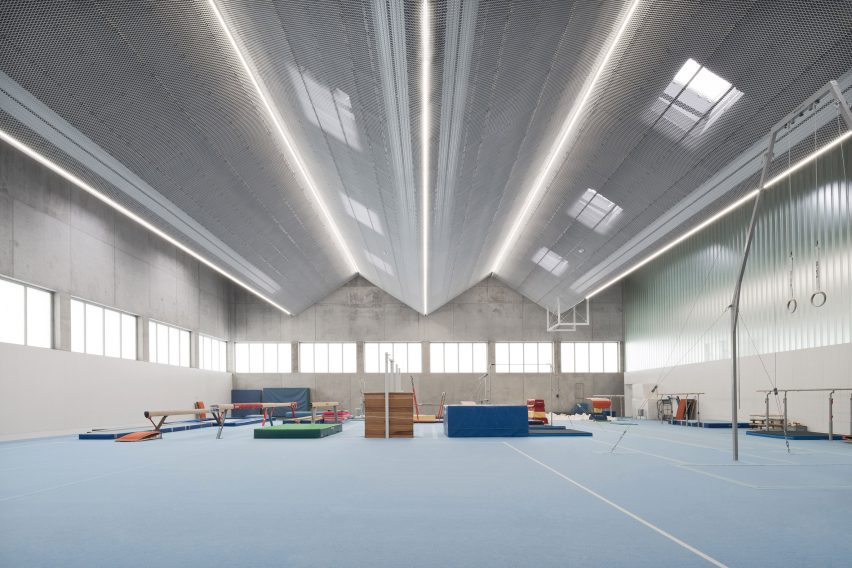 Large gymnasium with a blue floor