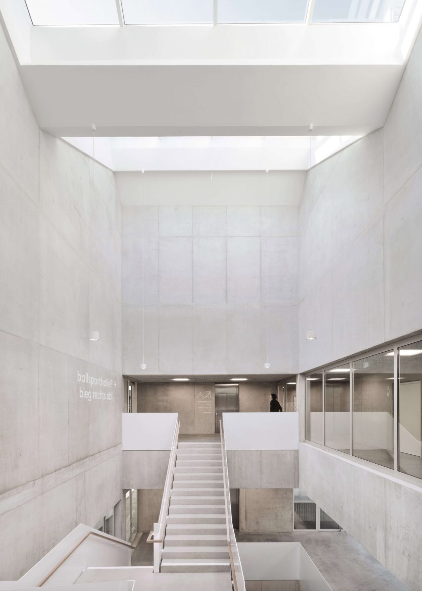 Raw concrete runs throughout the interior