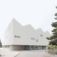 Wulf Architekten creates school sports centre with zigzag roof informed by the Alps