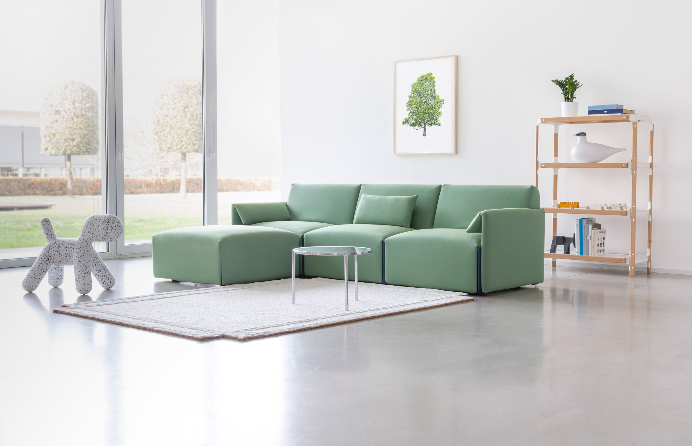 Green Costume sofa by Stefan Diez for Magis in a living room
