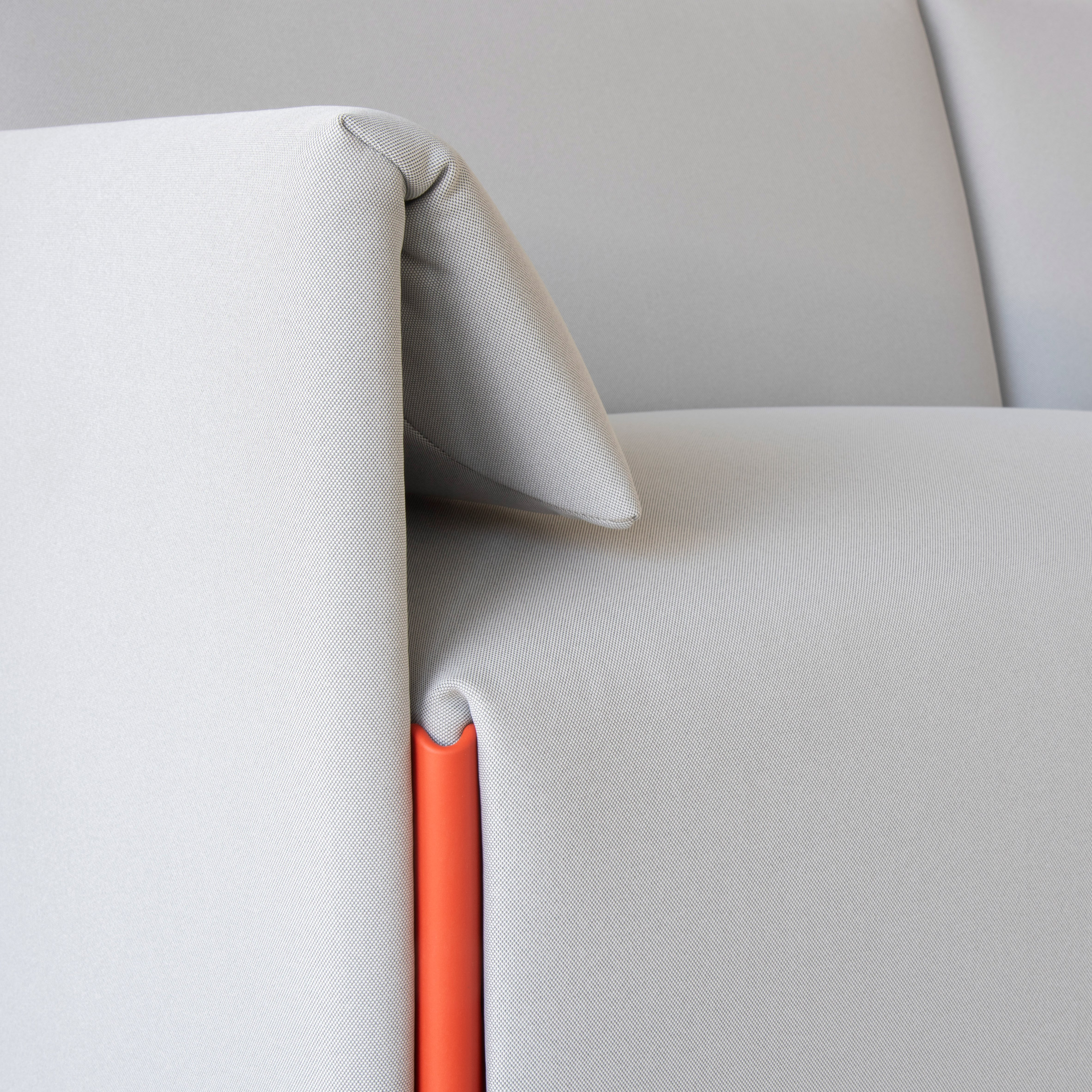 Grey Costume sofa by Stefan Diez for Magis with contrasting coloured connector